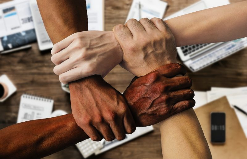 4 people holding each other's wrists